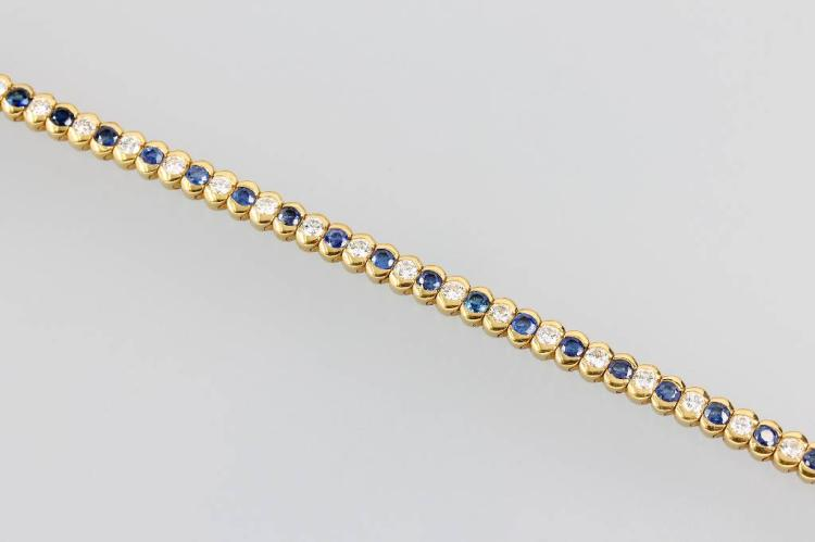 18 kt gold bracelet with sapphires and brilliants