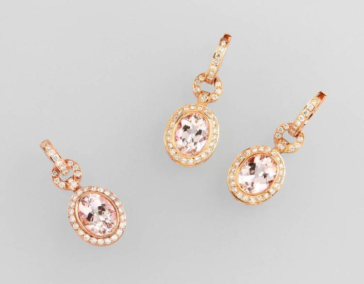 18 kt gold jewelry set with coloured stones and brilliants