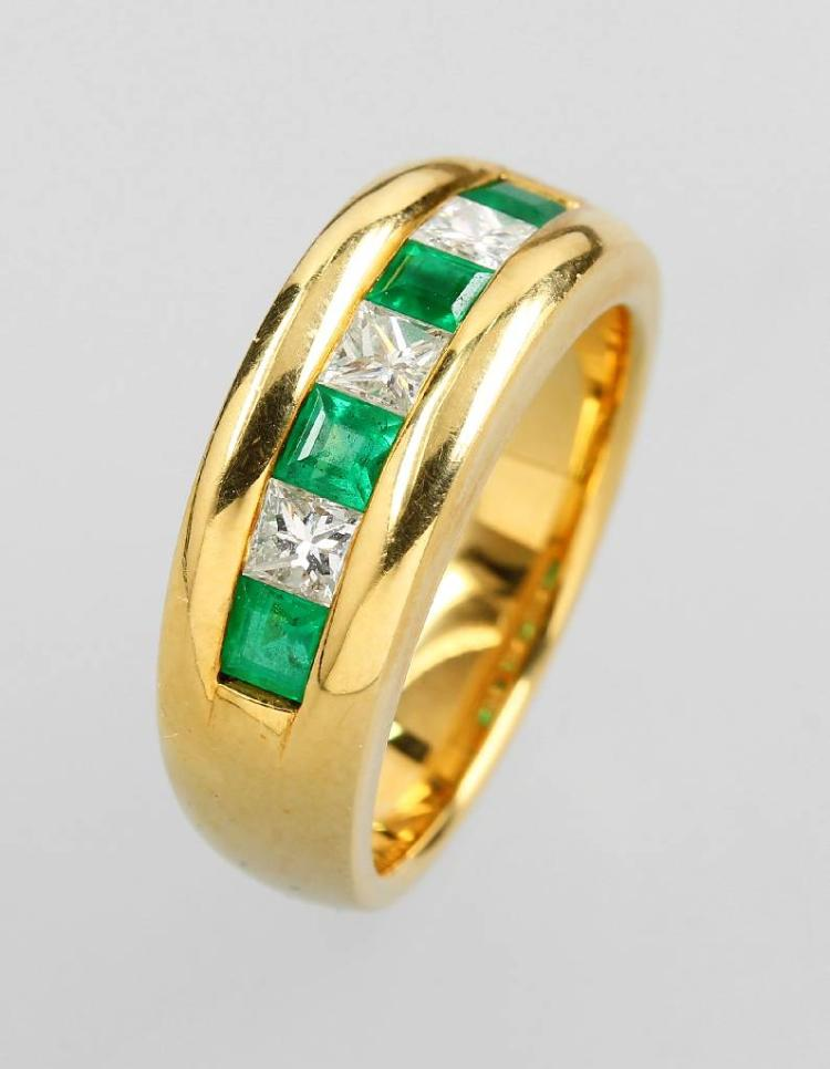 18 kt gold ring with emeralds and diamonds