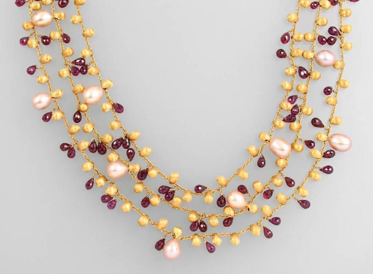 Unusual 18 kt gold designernecklace with rhodolites and pearls