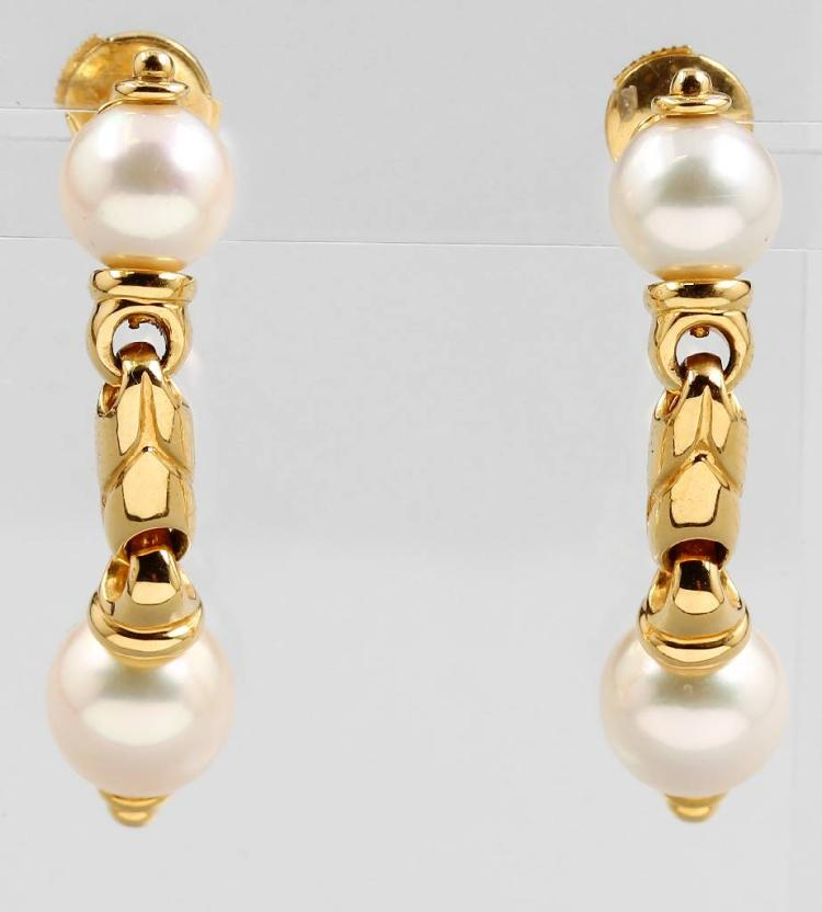 Pair of 18 kt gold earrings with pearls