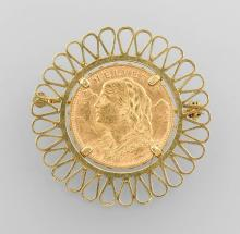 18 kt gold brooch with coin