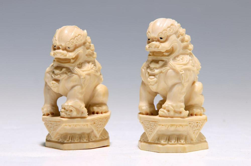 two ivory carvings, China, around 1920-30, Foo dogs