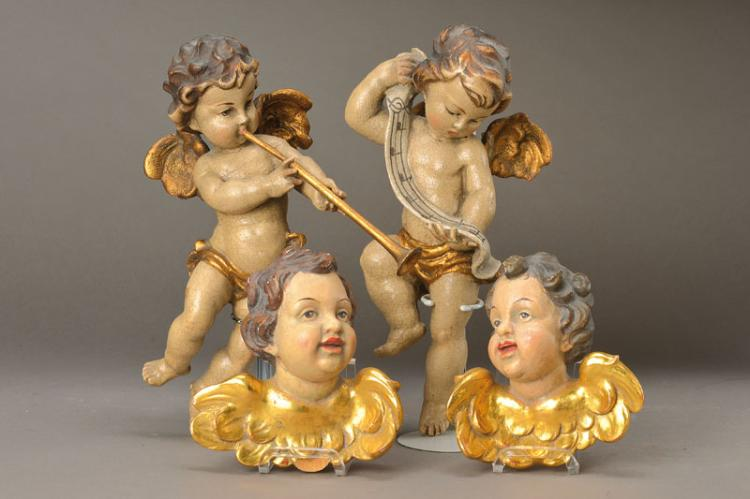 2 cupids/2 Putto heads