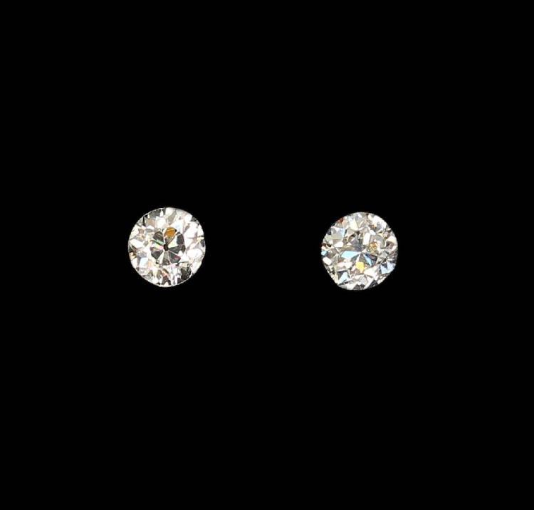 Lot 2 loose old cut diamonds