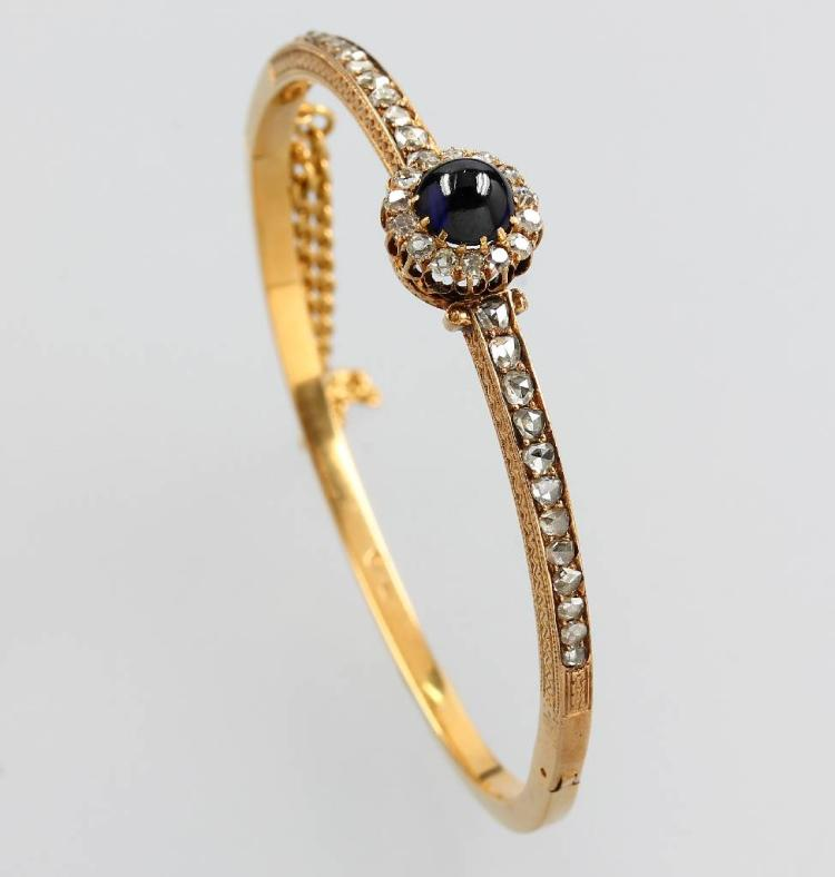 14 kt gold bangle with diamonds and sapphire