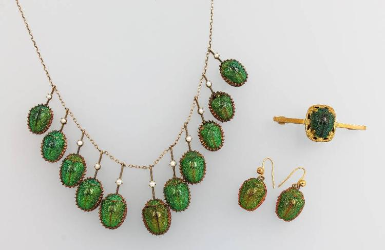 Set of jewelry: necklace, pair of earrings and brooch with scarabs