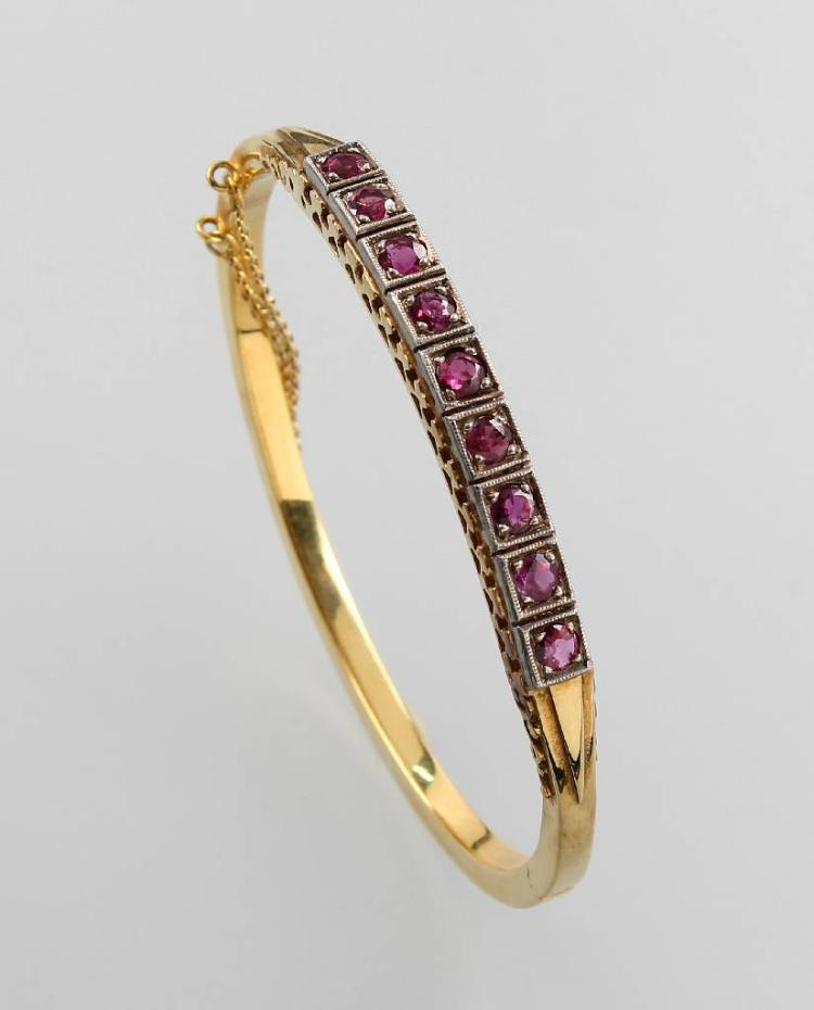 14 kt gold bangle with rubies