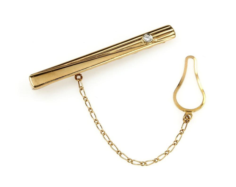 18 kt gold tiepin with diamond