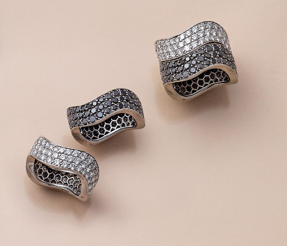 Pair of 18 kt gold CHOPARD rings with diamonds