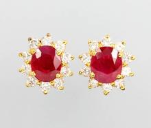 Pair of 18 kt gold earrings with rubies and brilliants