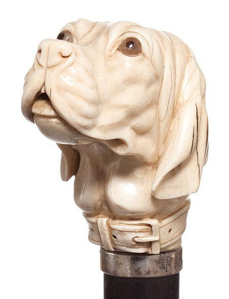 A CARVED IVORY AND WOOD DOG CANE Circa 1900 39 inches