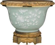 A Continental Pate-sur-Pate and Gilt Bronze-Mounted Porcelain Jardiniere, late 19th-early 20th century.