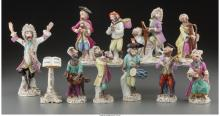 An Eleven-Piece Meissen-Style Painted Porcelain Monkey