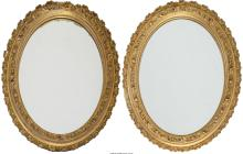A Pair of Louis XVI-Style Oval Carved Giltwood Mirrors,