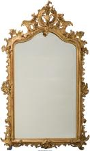A Large Louis XVI-Style Carved and Giltwood Mirror, 19th century 77-1/4 inches h