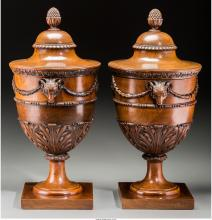 A Pair of George III-Style Carved Fruitwood Knife Urns, last quarter 19th centur
