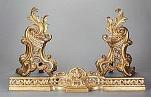 A PAIR OF LOUIS XV-STYLE GILT BRONZE CHENETS AND ASSOCI