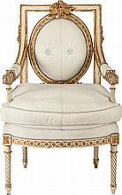 A LOUIS XVI-STYLE PAINTED WOOD AND PARCEL GILT UPHOLSTE