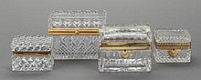 FOUR CUT GLASS AND GILT BRONZE TABLE BOXES, first half