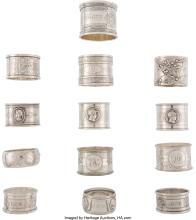 Lot 21026: A Group of Thirteen Silver and Silver-Plated Napkin Rings of Various Makers, lat