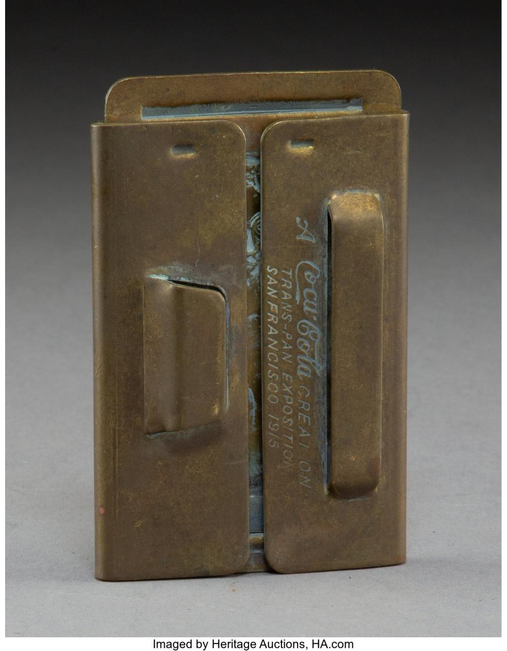 Lot 21191: A Coca Cola Brass Erotic Belt Buckle, 1915 Marks: A Coca Cola CREATION, TRANS-PA