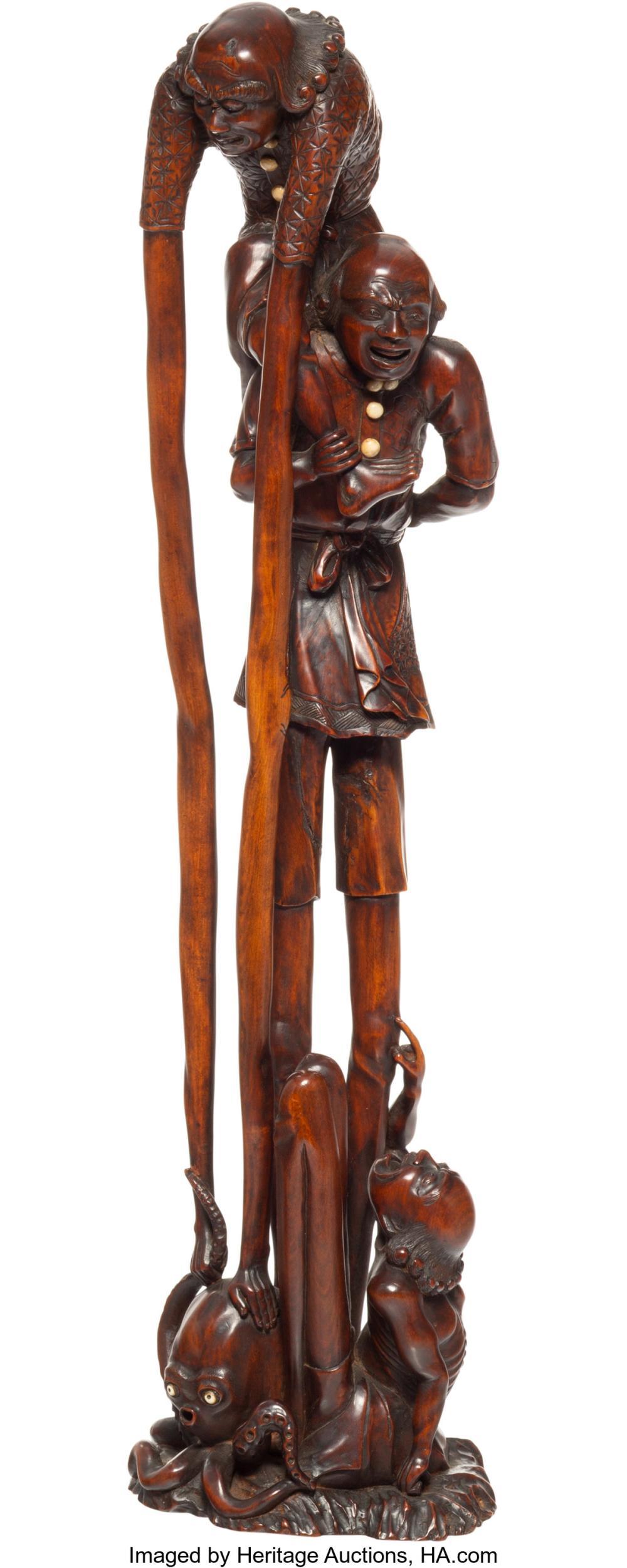 Lot 21251: A Japanese Carved Wood Ashinaga-Tenaga Figural Group, early 20th century 20-1/2
