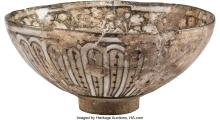 Lot 21261: A Persian Kashan Glazed Lusterware Bowl, Kashan, Persia, 14th century, possibly
