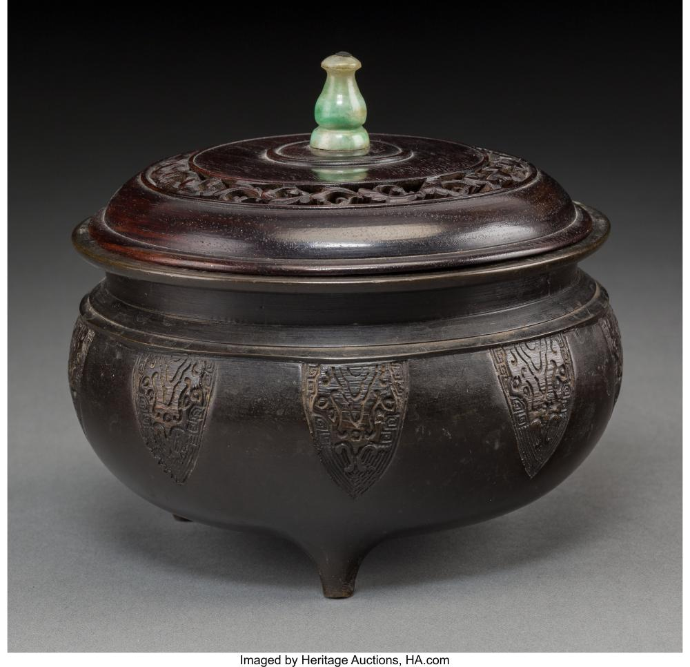 Lot 21270: A Chinese Bronze Tripod Censer with Hardwood and Jadeite Cover 5 x 5-1/2 inches