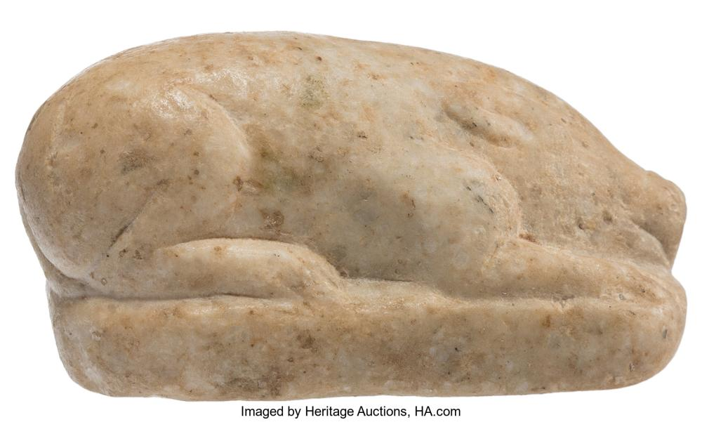 Lot 21299: A Chinese Carved Hardstone Pig, Sui Dynasty 2-1/2 x 3-1/8 x 1-5/8 inches (6.4 x