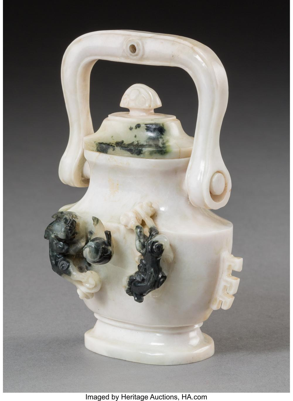 Lot 21282: A Chinese Carved White Jade Handled Urn 4-5/8 x 3-1/2 x 1-3/4 inches (11.7 x 8.9