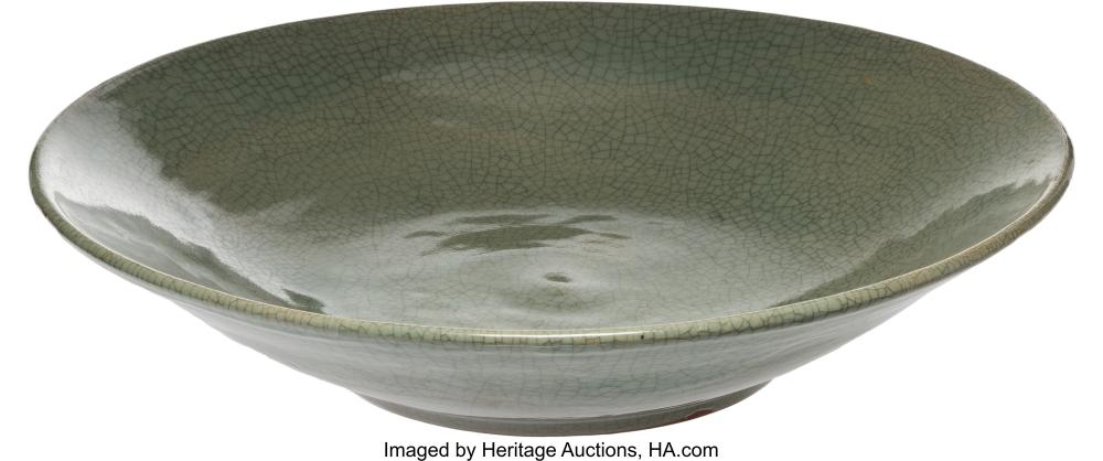 Lot 21311: A Chinese Crackle Glazed Celadon Porcelain Bowl 3-3/4 x 17-1/4 x 17-1/4 inches (