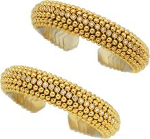 Diamond, Gold Bracelets  The cuffs feature full-cut dia
