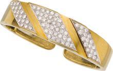 Diamond, Gold Bracelet, R. Stone  The hinged cuff featu