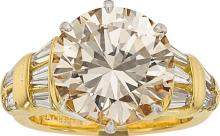 Diamond, Gold Ring  The ring features a round brilliant