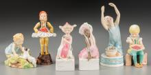 A Group of Six Royal Worcester Polychrome Porcelain Fig
