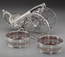 A Silver-Plated Wine Bottle Carriage and Two Bottle Coa