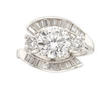 Diamond, Platinum Ring  The ring centers a round brilli