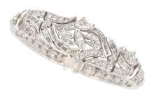 Diamond, Platinum Bracelet  The bracelet features marqu