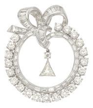 Diamond, Platinum Pendant-Brooch  The pendant-brooch fe