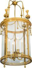 A Louis XVI-Style Gilt Bronze Four-Light Chandelier, 20