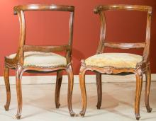 A Pair of Louis XV-Style Carved Fruitwood Fauteuils, la
