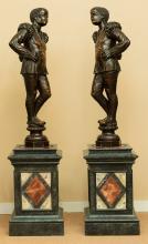 A Pair of Venetian Carved Walnut Blackamoor Figures wit