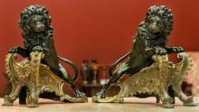 A Pair of Baroque-Style Gilt and Patinated Bronze Rampa