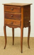 A French Provincial-Style Cherrywood Petit Commode, ear