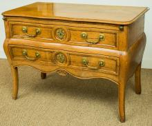 A Louis XV-Style Provincial Carved Oak Two-Drawer Commo