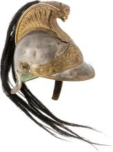 A CONTINENTAL PATINATED METAL GRENADIER PARADE HELMET.