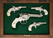 Cased Set of Four Engraved Colt Handguns.  Comprising: