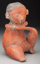 A Chinesco Seated Figure  100 BC - 250 AD   This figure
