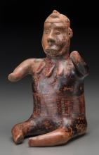 A Seated Colima Warrior with Incised Designs c. 200 BC